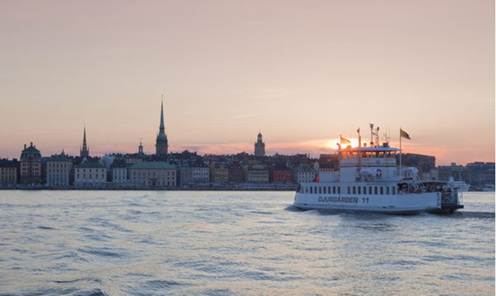 Sweden, Stockholm - Ferry heading for The Old Town at sunset