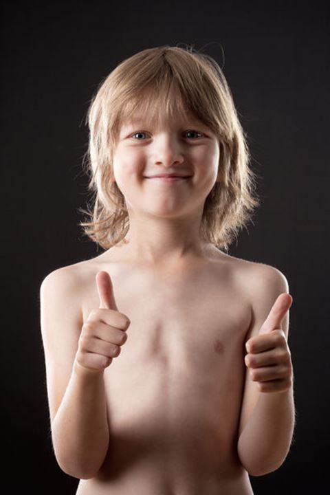 Boy with Blond Hair Showing Thumbs Up Hand Sign