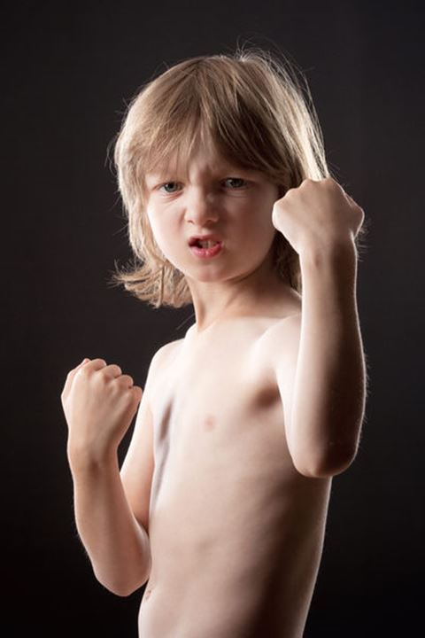 Boy with Blond Hair Striking a Fighting Pose