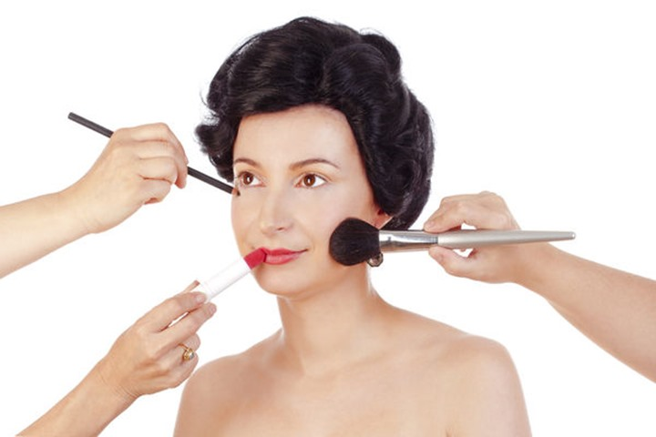Makeup Artists Preparing Model for Photo Shoot - Isolated on White