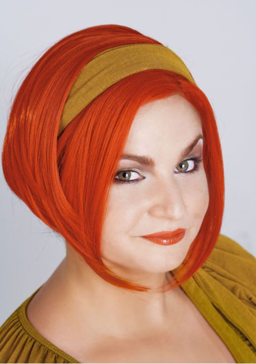 Portrait of a Young Woman in Red Wig - Isolated on Gray