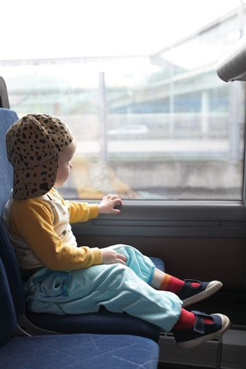 Small baby boy traveling by bus, Sweden.