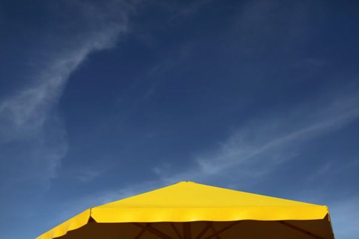 Yellow parasol against a blue sky, Sweden.