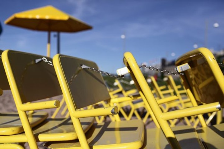 "Yellow chairs at a man made ""beach"" in central Gothenburg, Sweden."