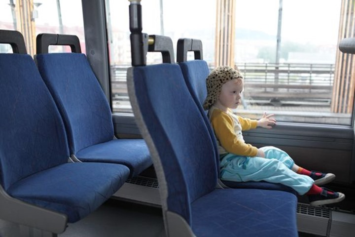 Baby boy traveling on a bus alone, Sweden.