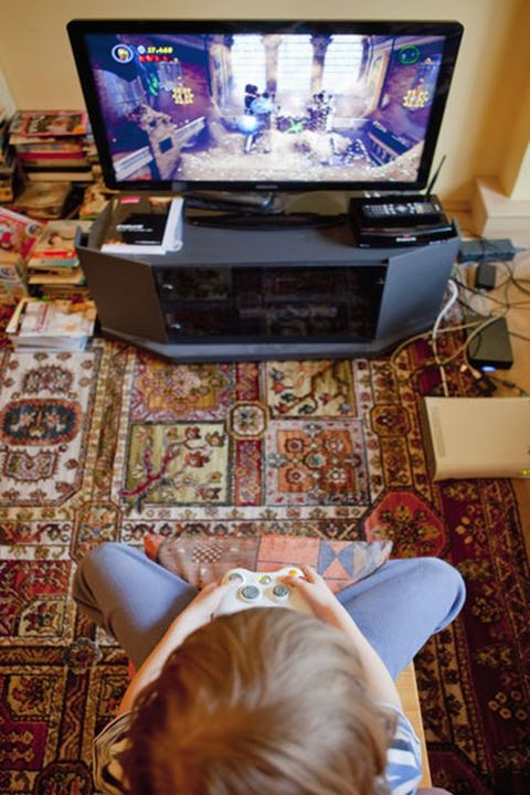 Boy Playing Console Game - View from Above