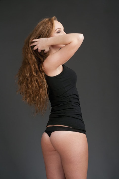 Young Beautiful Woman with Long Brown Hair in Black Top and Panties
