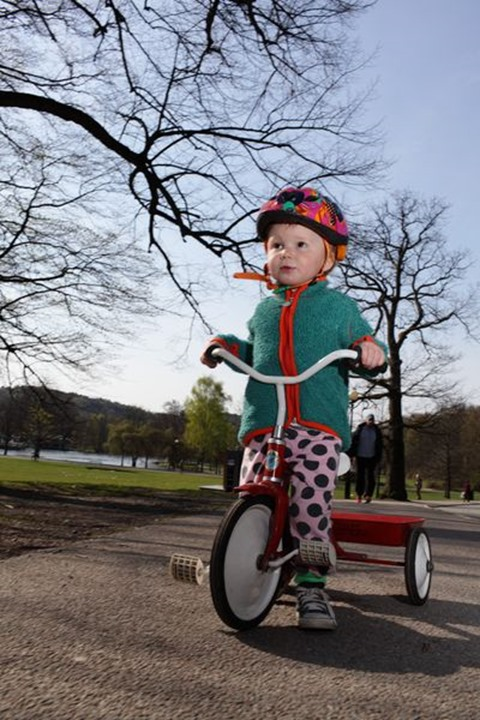 Small boy riding his bike, Sweden. Short depth of field, focus on his left eye.