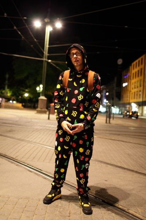 Young man walking the streets at night, Gothenburg (Göteborg), Sweden.