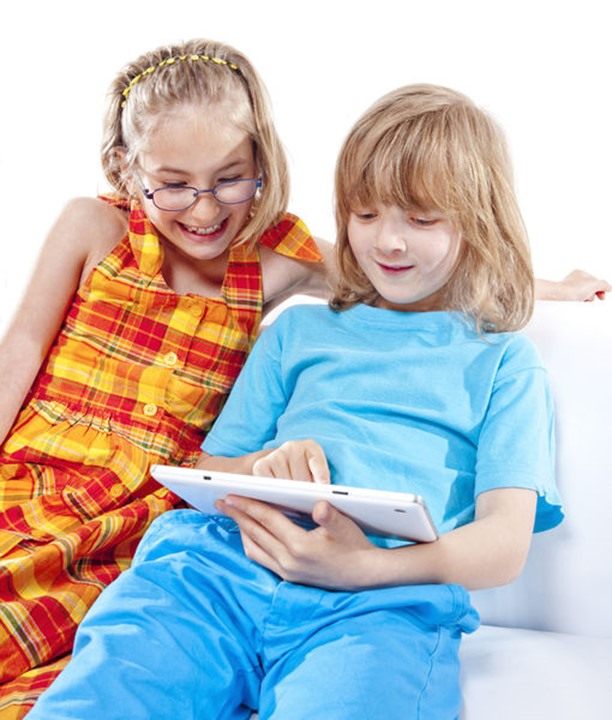 Two Children Having Fun with Digital Tablet - Isolated on White