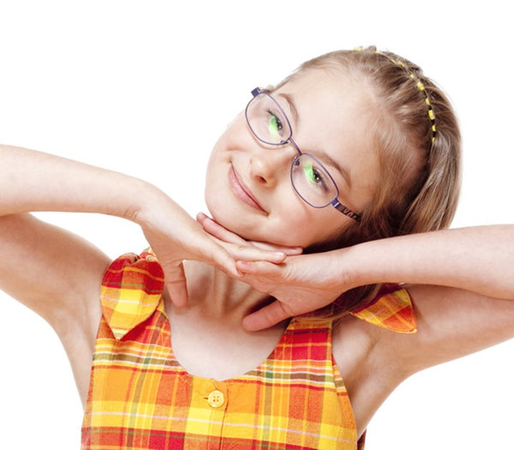 Portrait of a Little Girl with Blond Hair and Glasses - Isolated on White