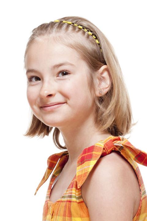 Portrait of a Little Girl with Blond Hair Smiling - Isolated on White