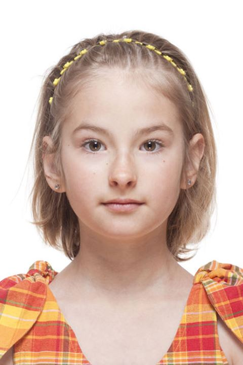 Portrait of a Little Girl with Blond Hair - Isolated on White