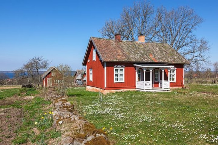 Red cottage with a garden in the spring