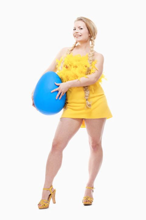 Easter - Young Woman with Long Blond Hair, Yellow Dress and Large Blue Egg.