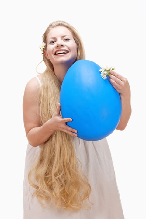Easter - Young Woman with Long Blond Hair and Large Blue Egg.