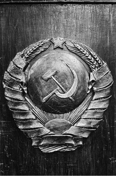 The symbol of the Soviet union. Cut in wood. Black/white.