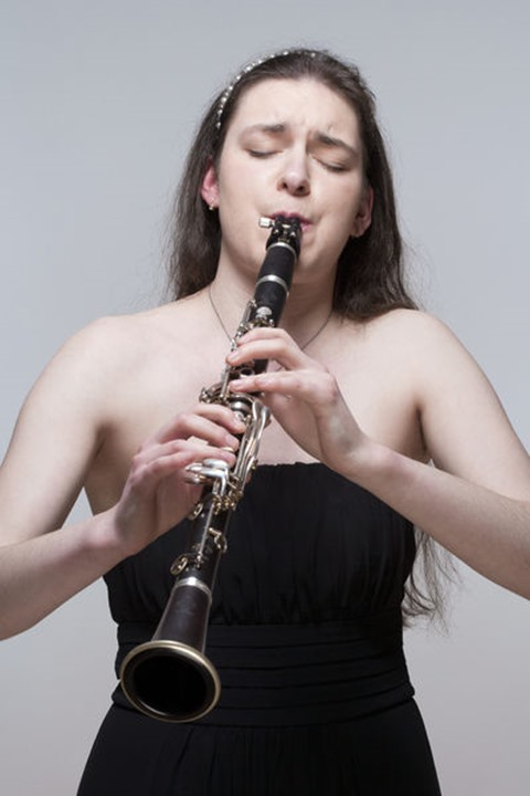 Portrait of Young Female Musician Playing Clarinet