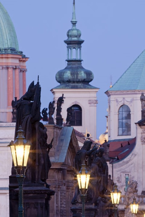 prague - religious art on charles bridge, lanterns and spires of the old town
