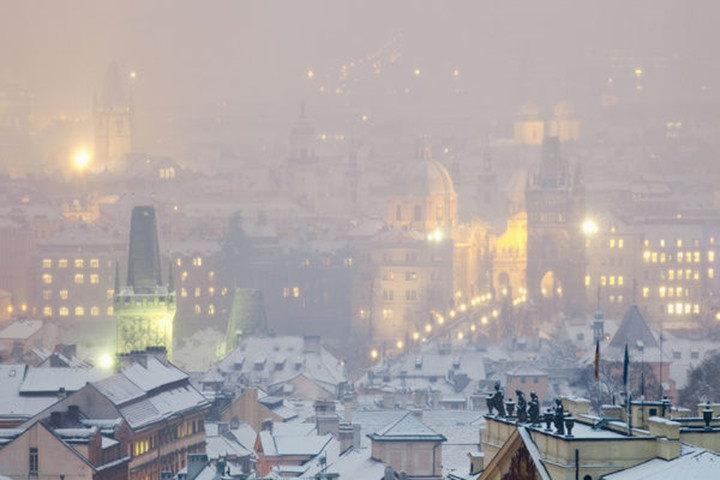Prague - Charles Bridge and spires of the Old Town during snowfall