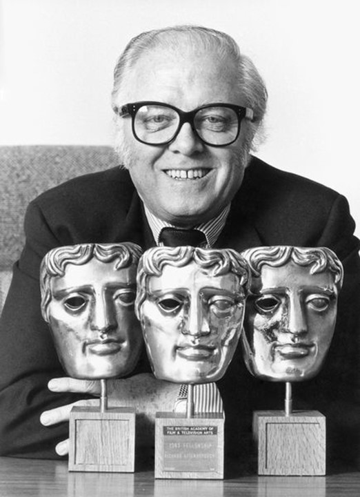 British film director Richard Attenborough with the three awards he received from the British Academy of Film (BAFTA) in 1983.