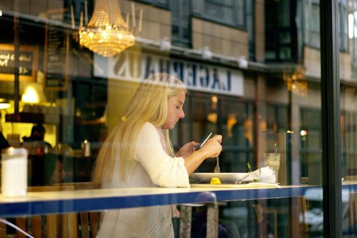 Young woman in a café, city of Stockholm