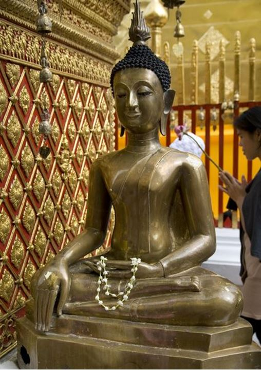 A statue of Buddha in the Wat Phra That Doi Suthep temple, Ciang Mai, northern Thailand