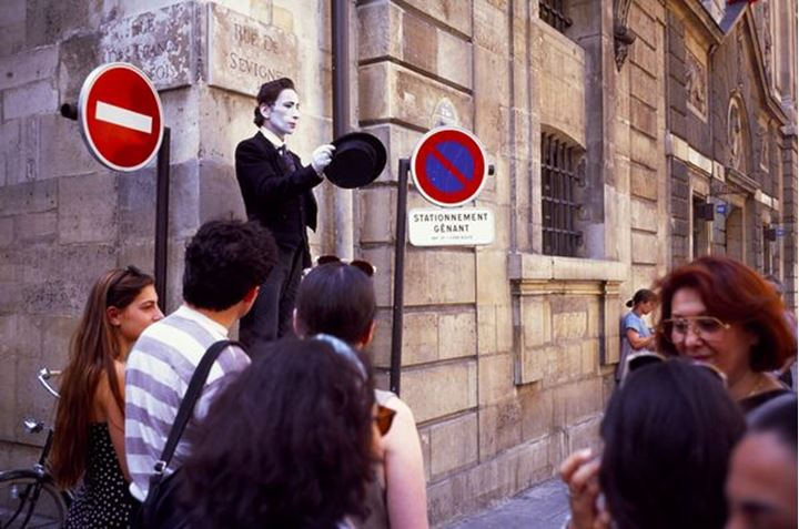 Street theatre, clown in Rue Sevigny Marais Paris France