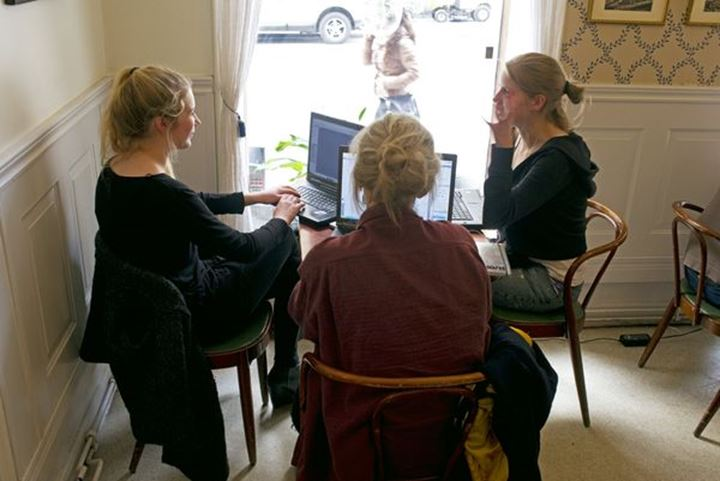 Young students studying together on a café in Stockholm