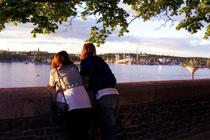 View over Stockholm Djurgården from the hights of the south; friends looking