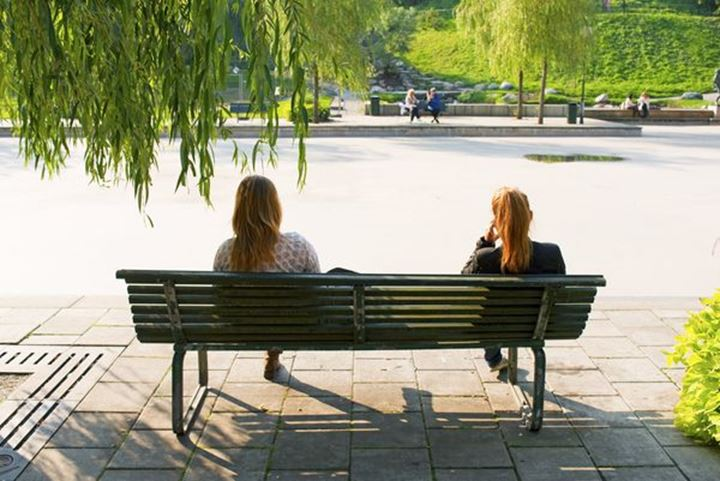 Two young women on a bench, Sveavägen Stockholm