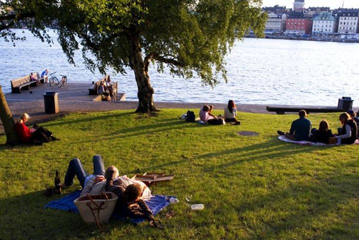 Picnic on the grass-slope near the hostel af Chapman Skeppsholmen Stockholm The old-town in the background