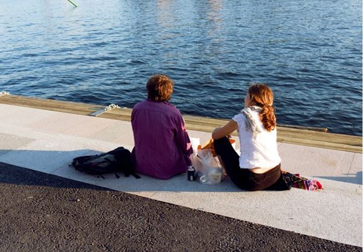 "Young couple overviewing the water ""Strömmen"" in Stockholm"