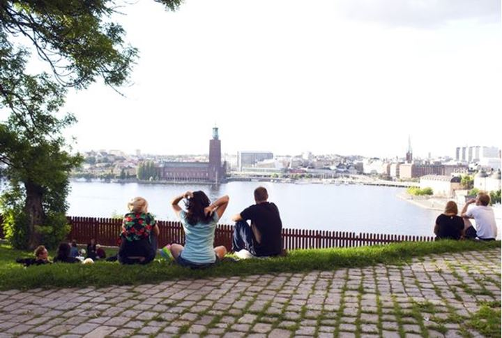 People having picnic overviewing Stockholm