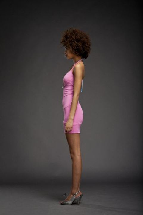 Girl with afro hair wearing pink dress, Gothenburg, Sweden