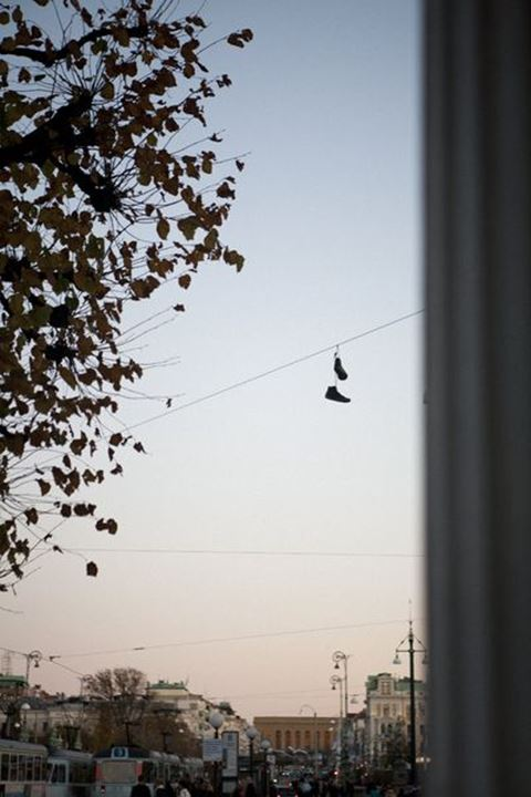 Pair of shoes hanging above street, Gothenburg, Sweden