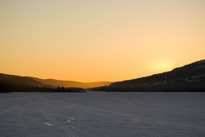 Sunset over frozen lake, re, Sweden