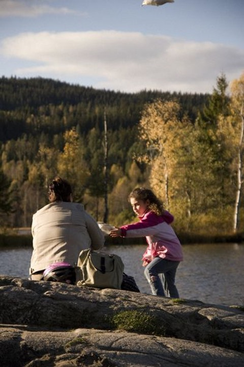 Mother and daughter by lake, Oslo, Norway