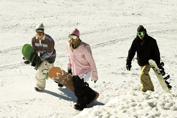 3 snowboarders hiking in slope, Sundsvall, Sweden