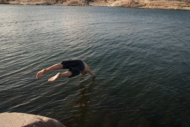 One man diving into the sea, Grebbestad, Sweden