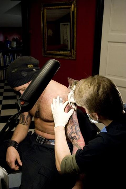 Man getting a tattoo, Oslo, Norway