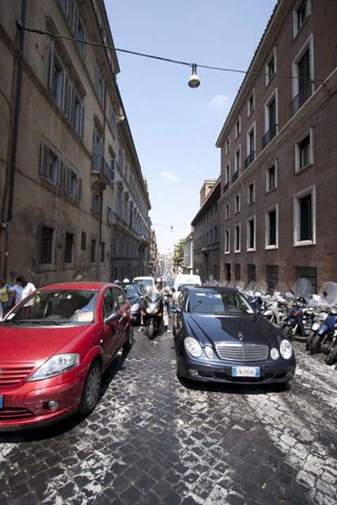 2 cars at crossing, Rome, Italy