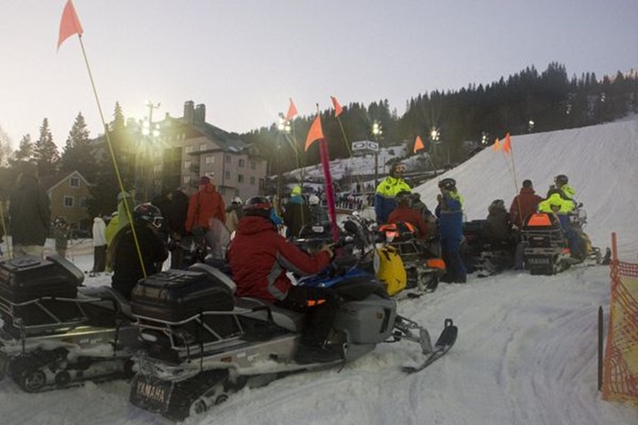Snowscooters close to big jump, Åre, Sweden
