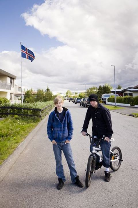Two boys during Independence Day.  Hafnarfjordur, Iceland.