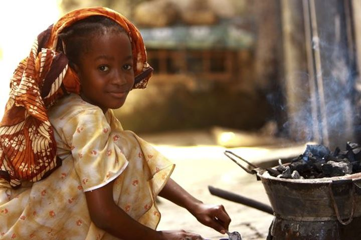 Young girl cooking dinner