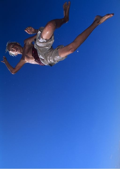 Low angle view of a boy jumping