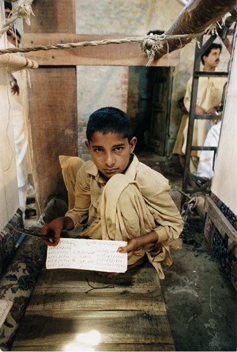Front view of a boy showing script