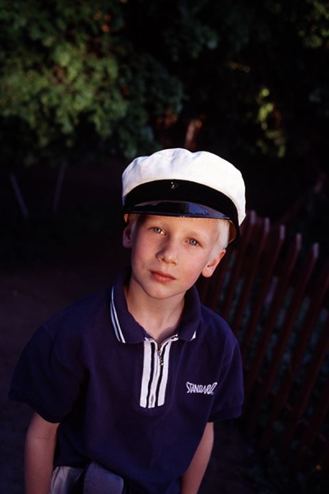 Close-up view of boy with marine hat looking at camera