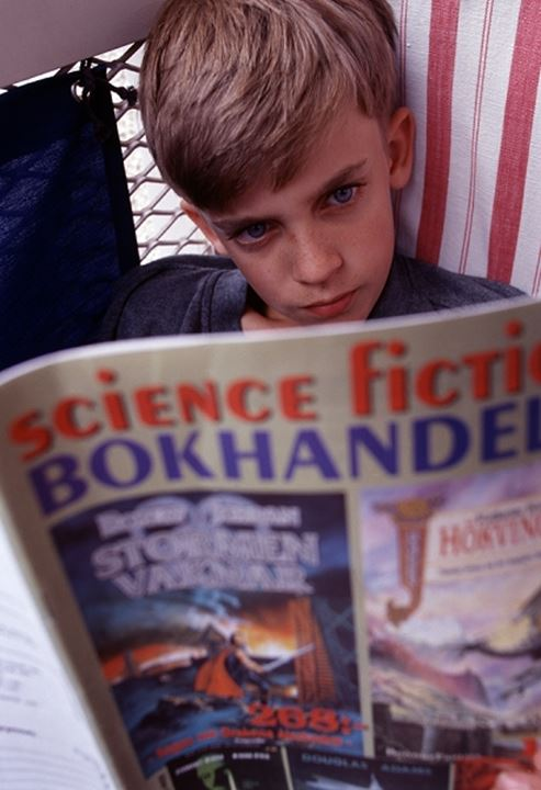 Close-up view of boy reading book