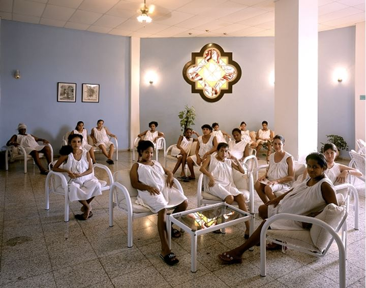 Women sitting while wearing white gown